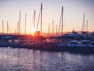 dock with white boats and yachts on a beautiful colorful sunset on the Cote d'Azur, France