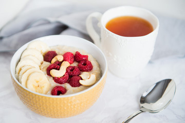 healthy oatmeal Breakfast with banana and raspberry
