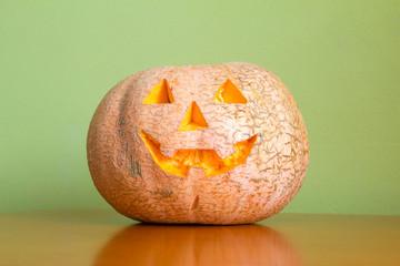 Halloween pumpkin on table, Jack O'Lantern on wood table