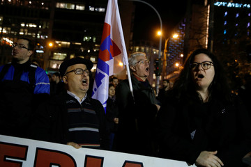 Protesters from the communist-affiliated trade union PAME shout slogans during a demonstration against property foreclosure auctions in Athens