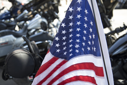 American Flag mounted on motorcycle, closeup view of stars and stripes