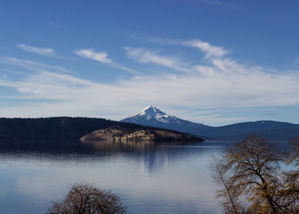Mount Mcloughlin reflecting on a lake.