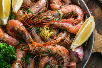 Many shrimps in a paella pan, cooking background