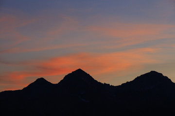 Silhouette of three mountain peaks in Sawtooth Mountains at sunset, Stanley, Idaho, USA
