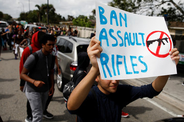 Students from South Plantation High School carrying placards and shouting slogans walk on the street during a protest in support of the gun control, following a mass shooting at Marjory Stoneman Douglas High School, in Plantation