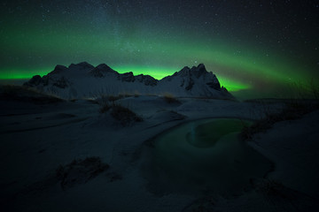 Green eye, aurora borealis at Stokksnes in Iceland