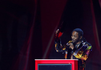 Kendrick Lamar accepts the award for international solo male artist at the Brit Awards at the O2 Arena in London