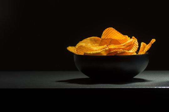 bowl of chips on dark background