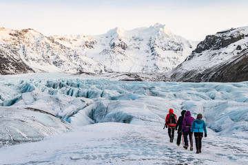 mountaineers hiking a glacier