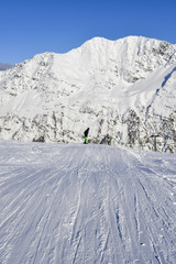 Selective focus of snowy slope in the famous and scenic ski resort of La Thuile, Aosta Valley, Italy