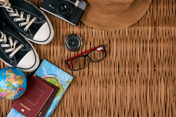 Summer vacation, travel, tourism and objects concept. Passport travel document photo camera sunglasses globe map, top view. Traveler items vacation travel accessories holiday long weekend day concept.