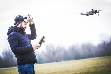 Young man with drone and virtual reality viewer