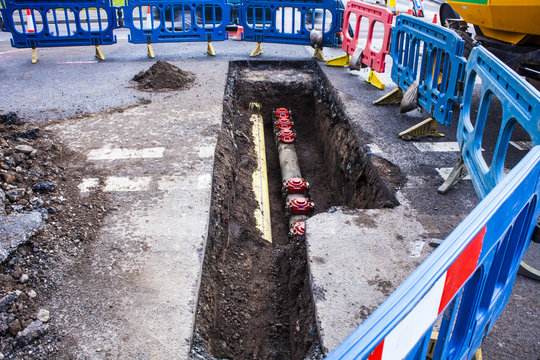 Installing new pipes in city street, mainstence work,