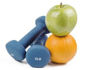 Dumb bells, apple and orange isolated on white