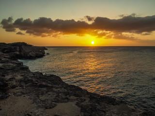 In de dag Baksteen Sunset on the cliff top Curacao views