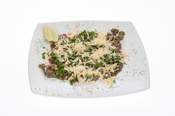 beef carpaccio with capers, parmesan, arugula, lemon and olive oil.