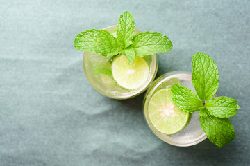Glass of iced lemonade soda, cold drink in summer