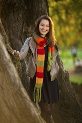 Beautiful young woman standing in park