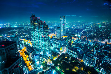 Asia Business concept for real estate and corporate construction - panoramic modern city skyline aerial night view of Shinjuku and Tokyo Metropolitan Expressway under twilight sky in Tokyo, Japan