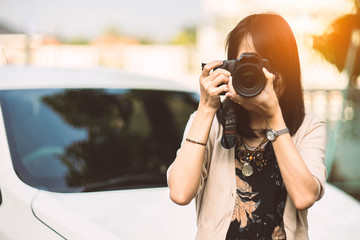young woman taking a photo at home.