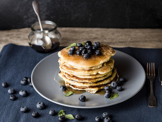 american pancake stack with blueberry topping