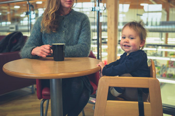 Mother with toddler drinking coffee
