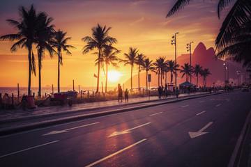 Sunset on Ipanema Beach with Dois Irmaos mountains in Rio de Janeiro, Brazil. Violet tone