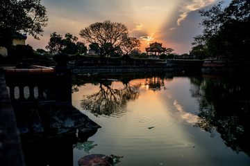 Sunset over the Imperial City in Hue, Vietnam. The Imperial City is a walled fortress and palace in the city of Huế, the former imperial capital of Vietnam.