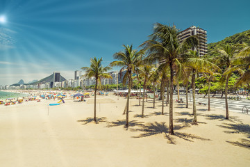 Copacabana Beach with palms. Light effect applied. Rio de Janeiro, Brazil