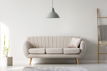 Lamp hanging above couch