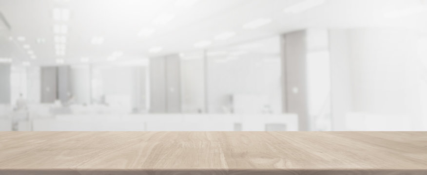 Empty wood table top and blurred bokeh office interior space banner background - can used for display or montage your products.