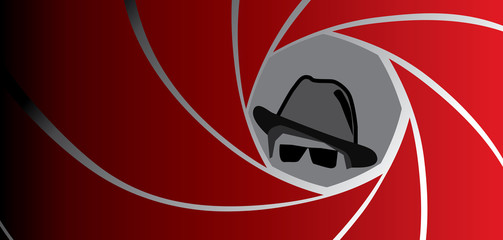 Silhouette of spy, secret agent, detective or gangster in fedora hat and sunglasses seen through a gun barrel. Vector illustration.