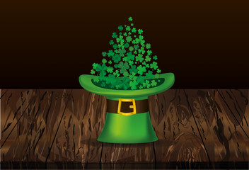 Clover inside the hat. The three-leaf leaves the cylinder. St.Patrick 's Day. Free space for your text or advertising. Greeting card or invitation. Vector illustration on wooden background
