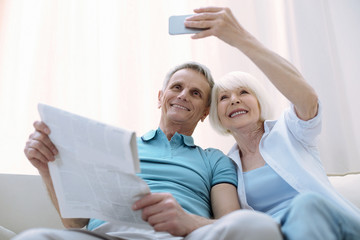 New photo. Active modern pensioners enjoying new technologies