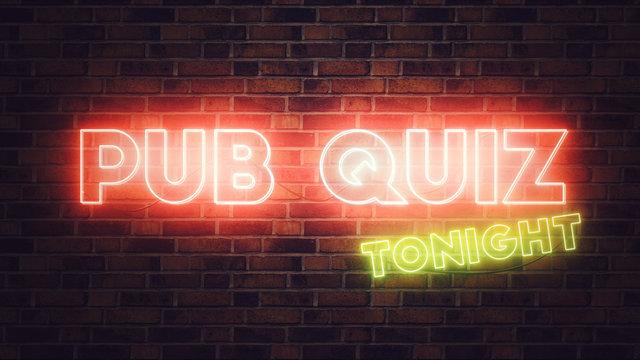 Pub Quiz neon sign mounted on brick wall