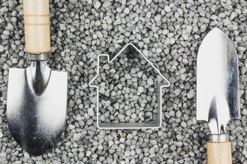 Trowel on the gray gravel. Garden tools, gardening.