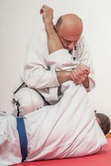 BJJ Brazilian jiu-jitsu training demonstration in traditional kimono