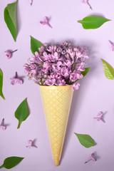 Ice cream cone with purple lilac