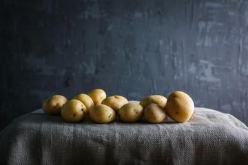 young, potato dark bacround moody food