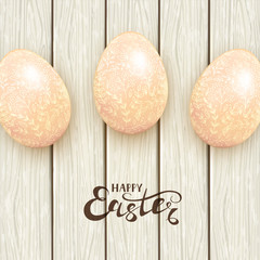 Easter eggs with floral pattern on white wooden background