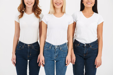 Cropped image of three smiling casual girls