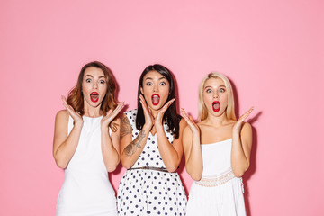 Portrait of three shocked young girls Wall mural