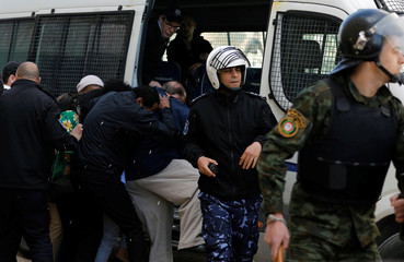 Eggs are thrown by Palestinian protesters at a U.S. delegation as Palestinian police evacuate them in Ramallah, in the occupied West Bank