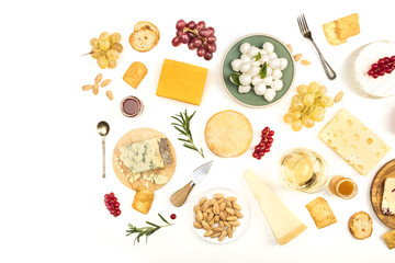 Various types of cheese with wine on a white background with copy space