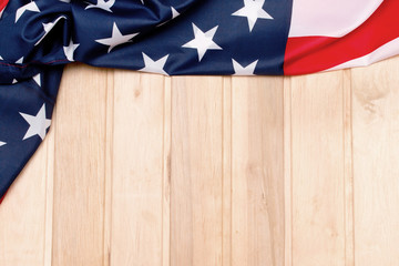 American flag on a light wooden background. The Flag Of The United States Of America. The place to advertise .
