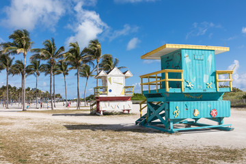 Lifeguard tower in a colorful Art Deco style, with blue sky and Atlantic Ocean in the background. World famous travel location. Miami Beach.