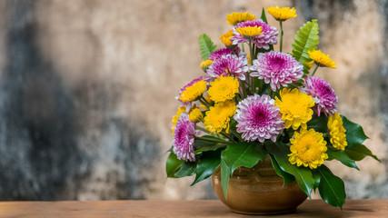 Chrysanthemum flower in a vase on wooden table