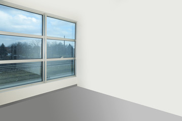 empty room with white walls and windows..