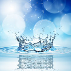 blue water splash on bokeh background.