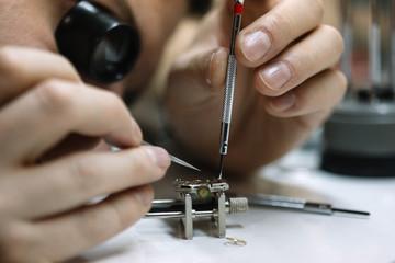 Close up of watchmaker repair mechanical watch